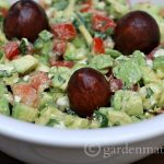 """Here's a recipe for guacamole that is """"dressed-up"""" with feta cheese and hot peppers. Great for a party or a Mexican themed dinner."""