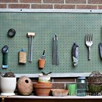 Adding a pegboard to your potting bench is a great decorative touch and a great way to organize all your gardening and other outdoor supplies.